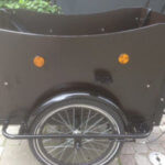 Electric Cargo bike left wood panel